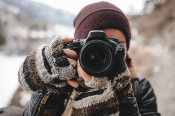 Close up portrait of photographer taking pictures with digital camera outdoor