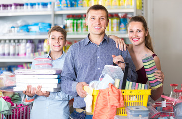 couple and teenager with household goods purchase in the store