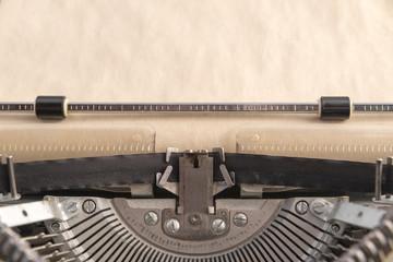 vintage typewriter. typing on paper. office. secretary.