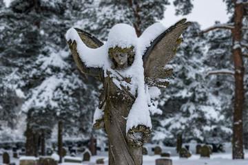 Snow covered Angel headstone in Wymondham Cemetery