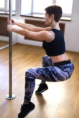 woman in a gym on a pole
