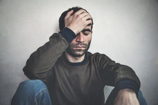 Caucasian depressed man.
