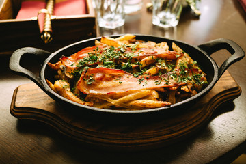 fried potatoes with meat and mushrooms