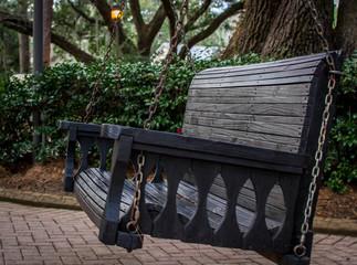 Swinging park bench