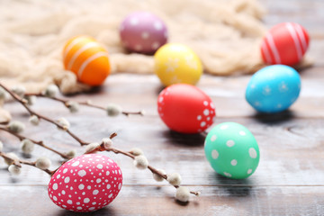 Colorful easter eggs on wooden table Wall mural