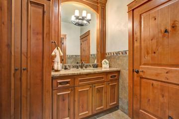 Bathroom with wooden bathroom vanity