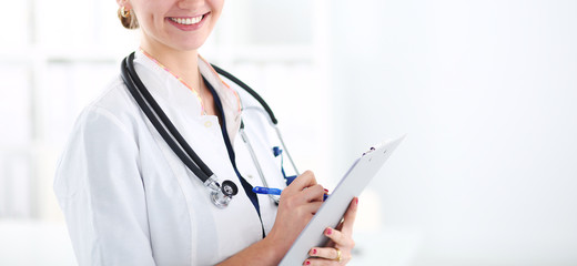 Woman doctor standing with stethoscope at hospital . Woman doctor