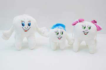 soft toys - a cheerful family of teeth with eyes and smiles. Stomatology. Tooth Health