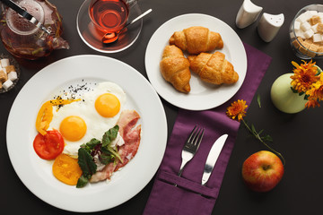 Restaurant breakfast with bacon and fried eggs