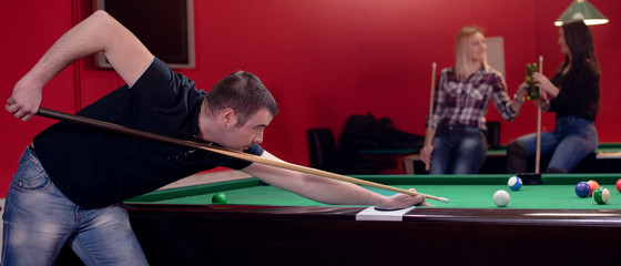 Panorama of a man playing pool
