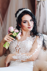 portrait of a bride with a small bouquet of a house