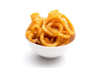 Seasoned Curly Fries in a White Bowl