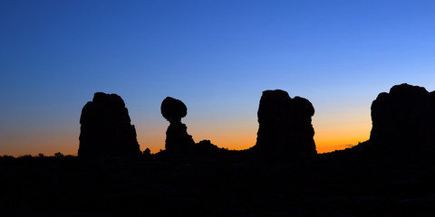 Sunrise behind Balanced Rock in Arches National Park, Utah