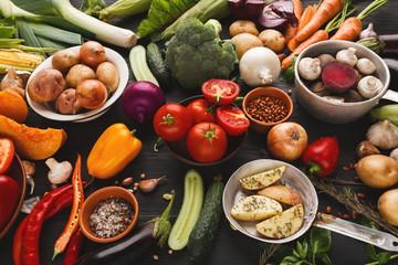 Fresh organic vegetables on wood background.