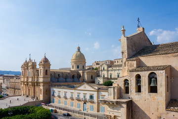 View of the baroque cathedral church, symbol of the city, you can also see the 3 bells of the Santissimo Salvatore church, Noto