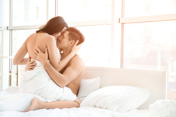 Sexy young lovers being intimate in bed