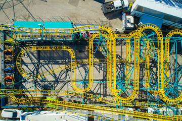Aerial drone image of a carnival roller coaster shot from above