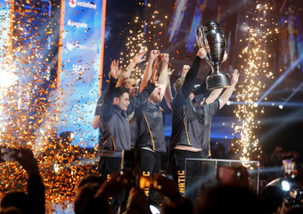 Fnatic team players celebrate their World Championship of the Intel Extreme Masters Katowice 2018 after esports final match of Counter-Strike: Global Offensive in Katowice
