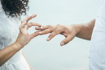 bridegroom wearing rings on the hands