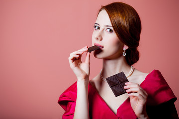 woman in red Victorian epoch clothes with chocolate