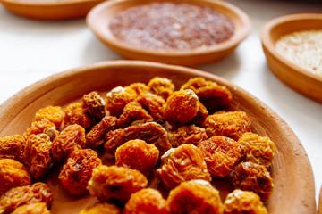 Macro closeup of dried Peruvian goldenberries in a ceramic dish