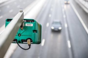 Winter snowy day view of average speed traffic camera over UK Motorway
