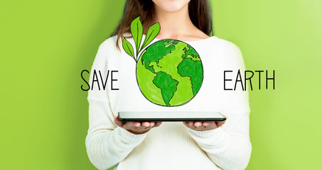 Save Earth with woman holding a tablet computer