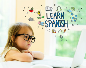 Learn Spanish text with little girl using her laptop