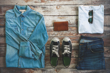 Traveler items vacation travel accessories for holiday or long weekend Simple Denim style Vintage Classic Hipster Look Clothing Overhead  view choice guide idea for planning travel around the world