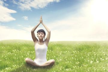 Sweet Asian Woman meditating outdoor