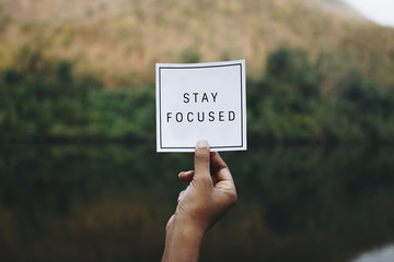 Stay focused text in nature inspirational motivation and advice concept Wall mural