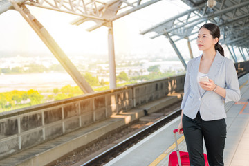 business woman walking on the rail platform