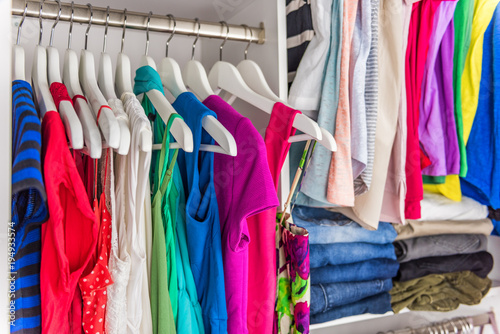 Fashion Clothes In Walk In Clothing Closet Or Store Display For Shopping  Display. Colorful