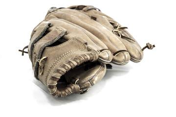 Old worn leather baseball glove on a white background.