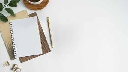 Styled stock photography white office desk table with blank notebook, computer, supplies and coffee cup. Top view with copy space. Flat lay. Wall mural