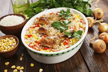 Chicken legs baked with rice and vegetables