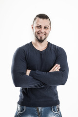 portrait of a sporty guy - bodybuilder in jeans and a t-shirt on
