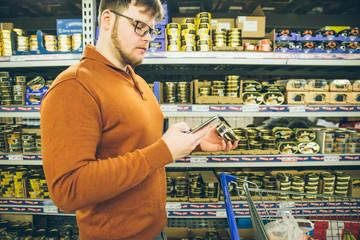 man check buy list on phone.