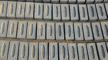 gray bricks arranged in rows and columns in brick field