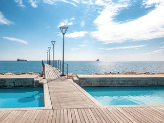 Fototapete - Island of Cyprus, Limassol. Beautiful embankment on a sunny day, wooden pier for walks