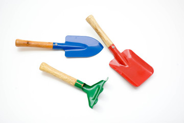 Gardening tools, spade, fork and rake  on white background