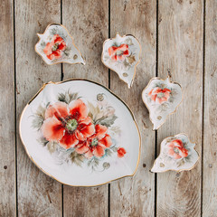 Souvenirs made of porcelain shot in the Studio with marshmallows and flowers. DIY and gift sets