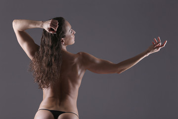 Bodybuilder woman showing her muscles.