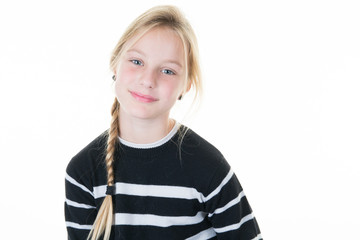Portrait of a pretty young blond girl standing against white background