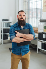 Confident bearded man staring intently at camera