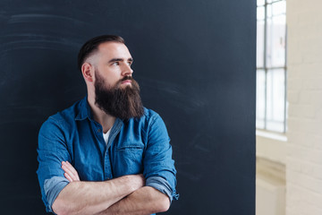 Casual bearded man with a neat hipster hairstyle