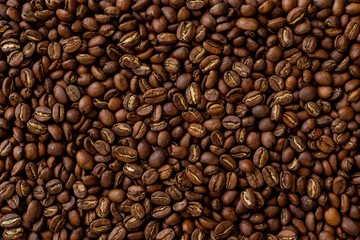 Texture, background. Roasted coffee beans, close up