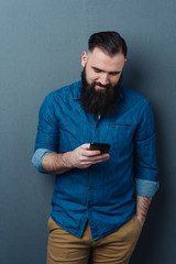 Relaxed casual guy reading a text message