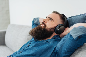 Happy relaxed man enjoying his music