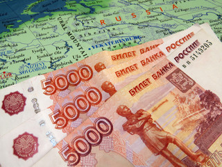 Russian rubles on the map of Russia. The Russian economy